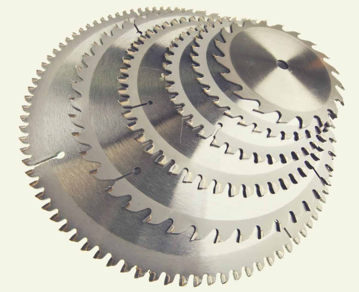 A pile of circular saw blades of various sizes