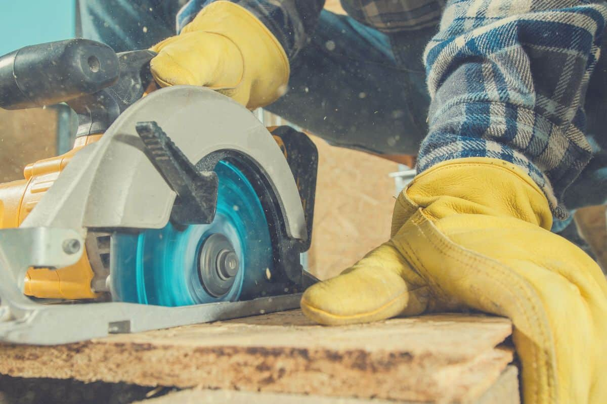 A close up of someone cutting with a circular saw