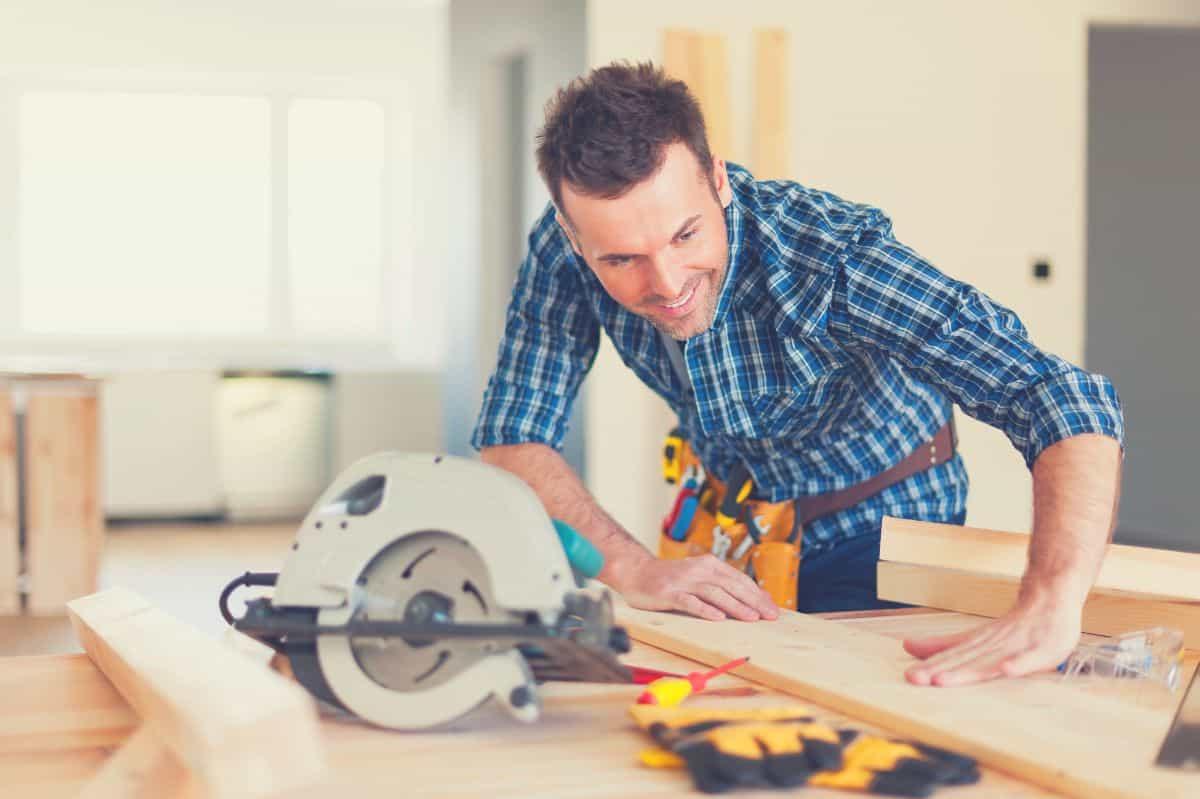 A man getting prepared to use a circular saw
